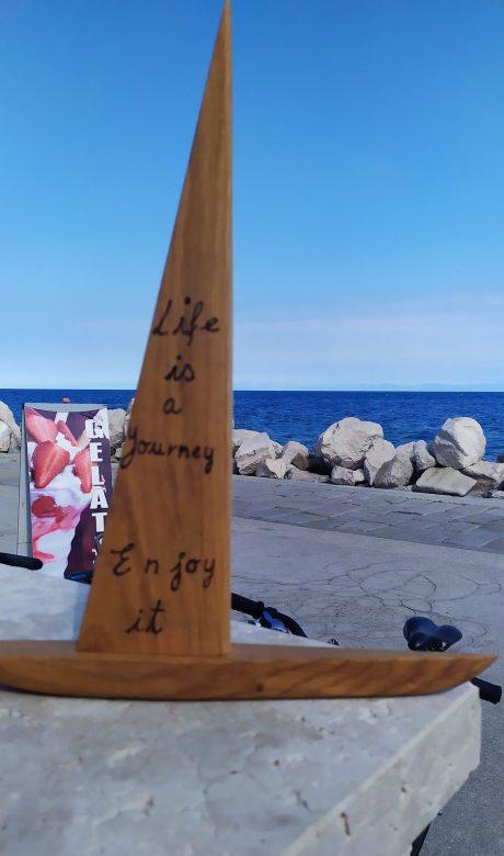 Wood sailing boat - life is a journey enjoy it